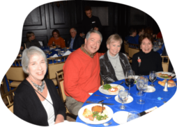 congregants seated at table for dinner event