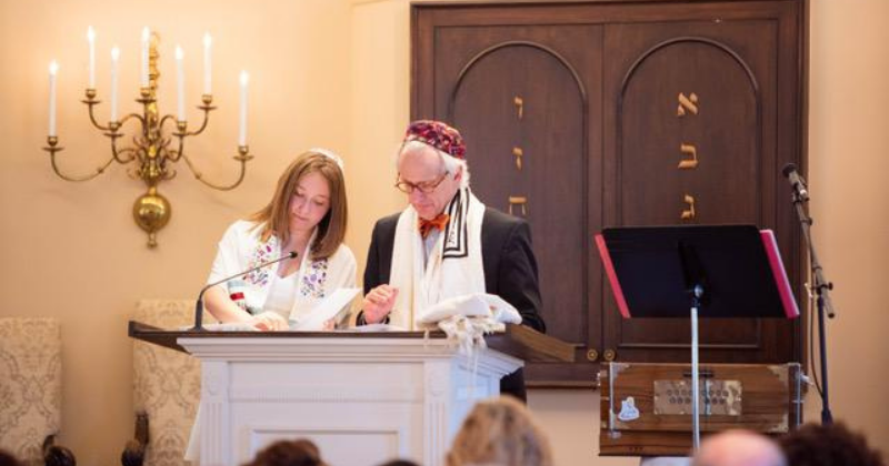 bat mitzvah reading from the torah with rabbi